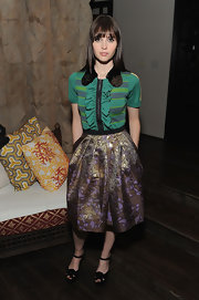Felicity Jones complemented her outfit with black strappy platform sandals.