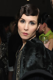Noomi Rapace added subtle sparkle to her beauty look with some metallic silver eyeshadow when she attended the Marni at H&M collection launch.