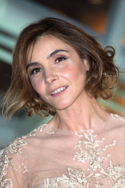 Clotilde Courau pinned her hair up in a messy-chic faux bob for the Marrakech International Film Festival.