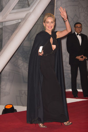 Sharon Stone toned down her sexy black gown with a flowing cape as she walked the Marrakech International Film Festival red carpet.