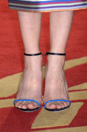 Marion Cotillared wore barely there Dior sandals featuring a vivid blue hue for the 13th Marrakech International Film Festival photocall of 'A Thousand Times Good Night'.