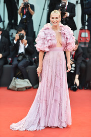 Molly Sims stole the spotlight in a pink Zuhair Murad Couture gown with ruffled sleeves and a plunging neckline at the Venice Film Festival screening of 'Marriage Story.'