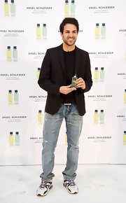 Cesc Fabregas promoted a new fragrance while wearing jeans and a classic black blazer.