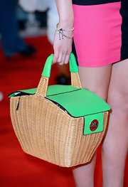 Emily Head got creative with this picnic basket-turned-handbag on the red carpet of the 'Avengers' premiere.