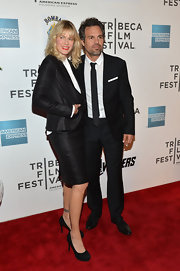 Sunrise matching Mark in her black shiny blazer at the Tribeca Film Festival.