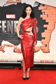 Krysten Ritter was red-hot in an asymmetrical Julien Macdonald dress with a waist cutout at the New York premiere of 'The Defenders.'