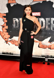 Jessica Henwick attended the New York premiere of 'The Defenders' wearing a patched one-shoulder gown by Vionnet.