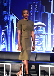 Danai Gurira opted for a simple khaki sheath dress by Altuzarra when she attended the 'Black Panther' global junket press conference.
