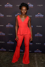 Lupita Nyong'o matched her top with a pair of red bell-bottoms, also by Cushnie et Ochs.