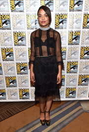 Tessa Thompson worked a Marc Jacobs LBD with a sheer bodice and a scalloped skirt at the Comic-Con 2017 Marvel Studios panel.