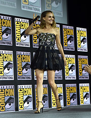 Natalie Portman went for flirty elegance in a strapless mini dress by Dior at Comic-Con International 2019.
