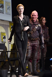 Elizabeth Debicki went for pajama glamour in a sheer black top with gold trim for the Marvel Studios panel during Comic-Con.