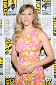 Scarlett's soft blonde locks looked super sweet when styled with a pink lip and floral frock.