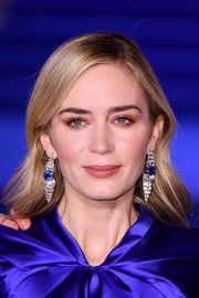 Emily Blunt complemented her dress with a pair of sapphire and diamond chandelier earrings.