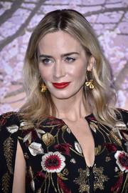 Emily Blunt polished off her look with a pair of petal-embellished gold hoops by Lorraine Schwartz.