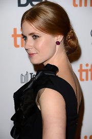 Amy Adams wore her famous red hair in a low wrapped 'do for the premiere of 'The Master' at the Toronto Film Festival.