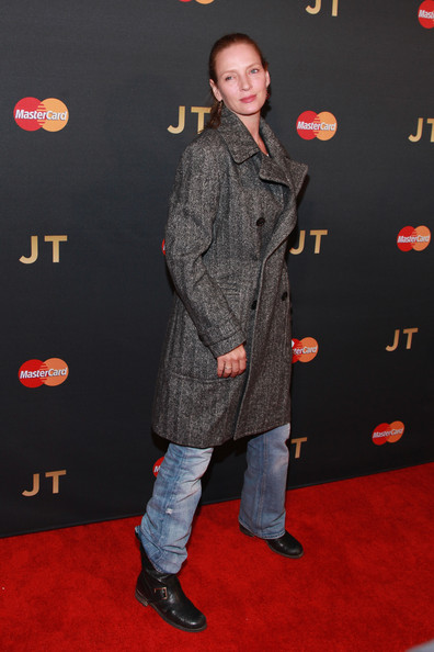 Uma Thurman's black moto boots were a rugged contrast to her sophisticated trenchcoat during Justin Timberlake's concert.