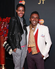 Marcus Samuelsson matched a white blazer with a red vest and a patterned gold scarf for Justin Timberlake's concert.