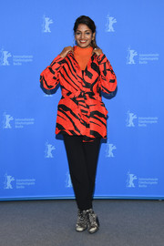 M.I.A. sealed off her look with a pair of monochrome lace-up boots.