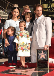 Vida McConaughey nearly upstaged dad Matthew during his Walk of Fame ceremony when she struck the standard red-carpet cross-ankle pose in a charming Dolce & Gabbana floral frock.
