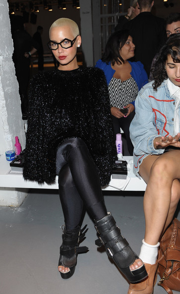 Amber showed off a pair of killer multi buckle boots while hitting Pam Hogg fashion show.