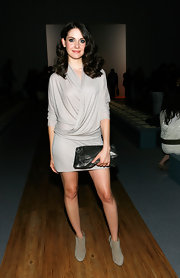 Alison Brie paired nude ankle boots with her chic dress for an edgy touch.