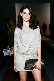 Alison Brie went for a modern vibe with this chainmail clutch and short wrap dress combo at the Max Azria fashion show.