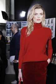 Lily Donaldson looked cozy in a red turtleneck while waiting backstage at the Max Mara fashion show.