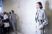 Kaia Gerber was edgy-chic in a gray trenchcoat while waiting backstage at the Max Mara Spring 2020 show.