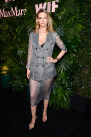 January Jones showed off her legs in a sheer-bottom skirt suit at the Max Mara WIF Face of the Future event.