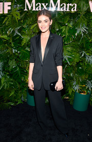 Lucy Hale complemented her suit with a faceted clutch by Tyler Ellis.