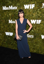 Constance Zimmer wore a navy V-neck column dress by Max Mara during the Women in Film Face of the Future Award.