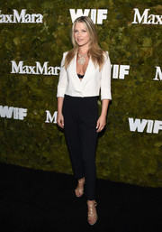 Ali Larter showed some cleavage in a plunging white cropped jacket by Max Mara at the Women in Film Face of the Future Award.