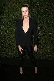 Ireland Baldwin put on an eye-popping display in a black blazer, which she wore sans shirt and bra, at the Max Mara Face of the Future event.