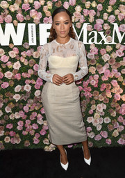 Serayah attended the 2017 Face of the Future event wearing a nude corset dress over a sheer printed top.