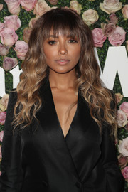 Kat Graham got dolled up with this long wavy hairstyle with choppy bangs for the 2017 Face of the Future event.