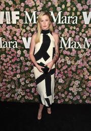 Ireland Baldwin attended the 2017 Face of the Future event wearing a patched midi dress by Max Mara.