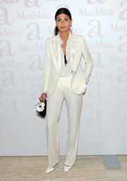 Giovanna Battaglia was androgynous-chic in a white pantsuit during the Max Mara accessories campaign celebration.