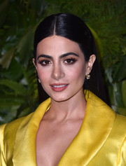 Emeraude Toubia sported a sleek straight hairstyle at the Max Mara WIF Face of the Future event.