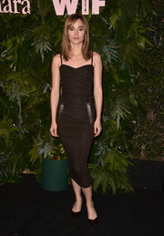 Suki Waterhouse flaunted her slim physique in a ruched brown midi dress at the Max Mara WIF Face of the Future event.