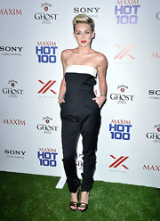 Miley's strapless black jumpsuit looked sleek and cool on the young star.