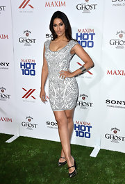 Janina Gavankar chose a gray-and-white patterned frock for her sexy look at the Maxim Hot 100 Party.