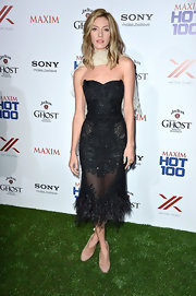Dawn Olivieri chose this strapless fitted dress that featured a beaded bodice and skirt and a feathered hem.