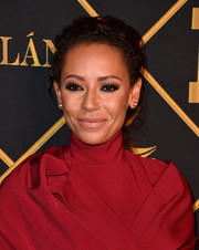 Melanie Brown swept her curls back into a loose ponytail for the Maxim Hot 100 Party.