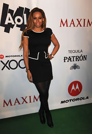 Melanie Brown paired a ladylike peplum dress with black leather over the ankle boots.