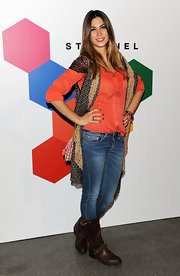 Melissa Satta went casual on the red carpet in these comfy brown flat boots.