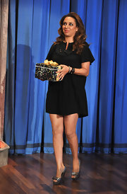 Maya Rudolph showed off her legs in these silver peep-toe pumps.