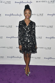 Skai Jackson continued the shimmer with a pair of mirrored silver pumps by Aldo.