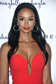 Draya Michele wore her long hair down with a center part and barely-there waves during Maybelline's Los Angeles Influencer event.