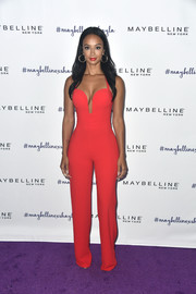 Draya Michele worked her curves in a fitted red jumpsuit with a cleavage-flaunting neckline during Maybelline's Los Angeles Influencer event.